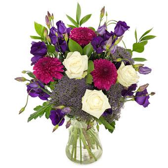 färgrikrund blombukett med olika lila toner